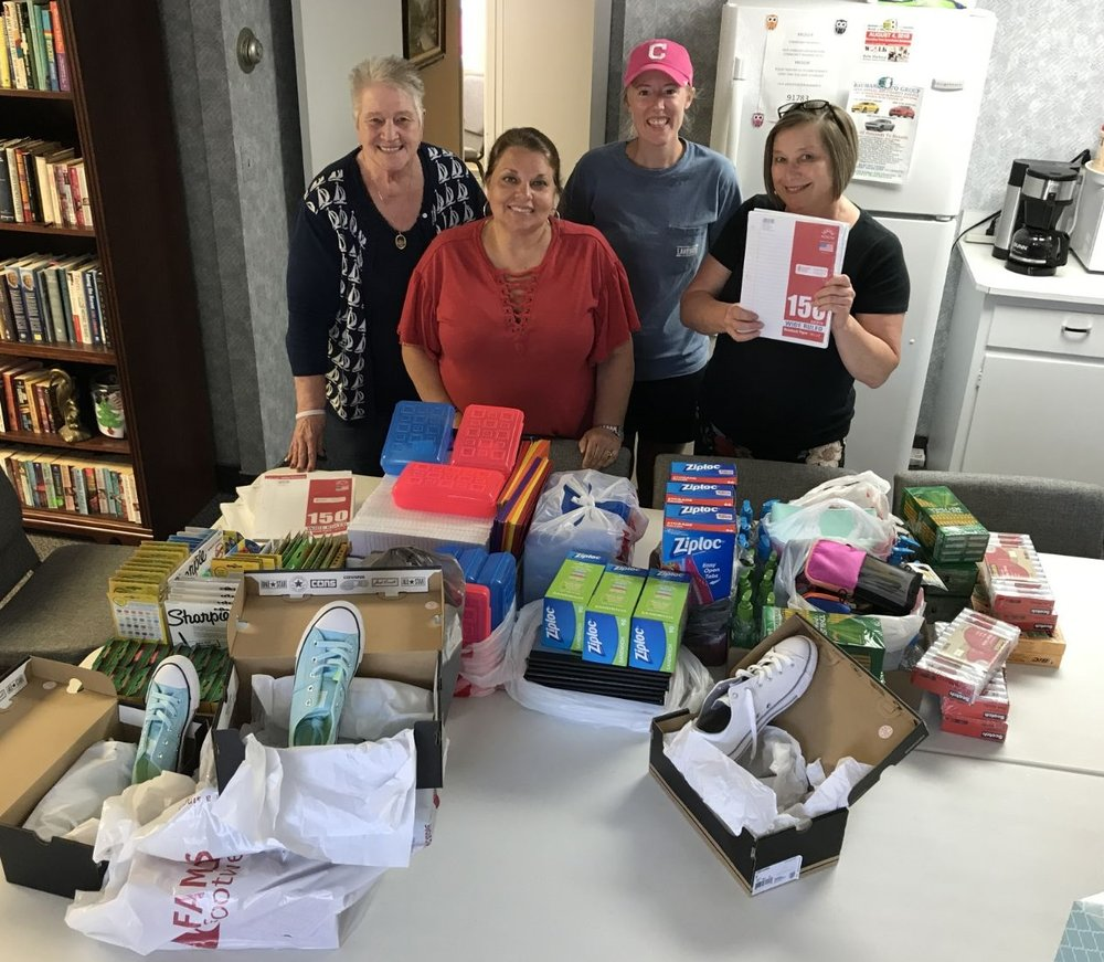 Pictured, from left: Safe Harbor director Linda Mitchell, Beth Wimmer, Hannah LeBran and Hazel Foley with a very small portion of the latest items donated to the shelter.