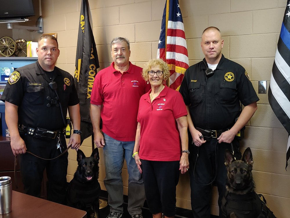 Pictured from left:  Officer Allen Dorsey with Eda, Fremont Elks Exalted Ruler Mike Mowry & Mary Beaston, and Officer George Dorsey with Hayes