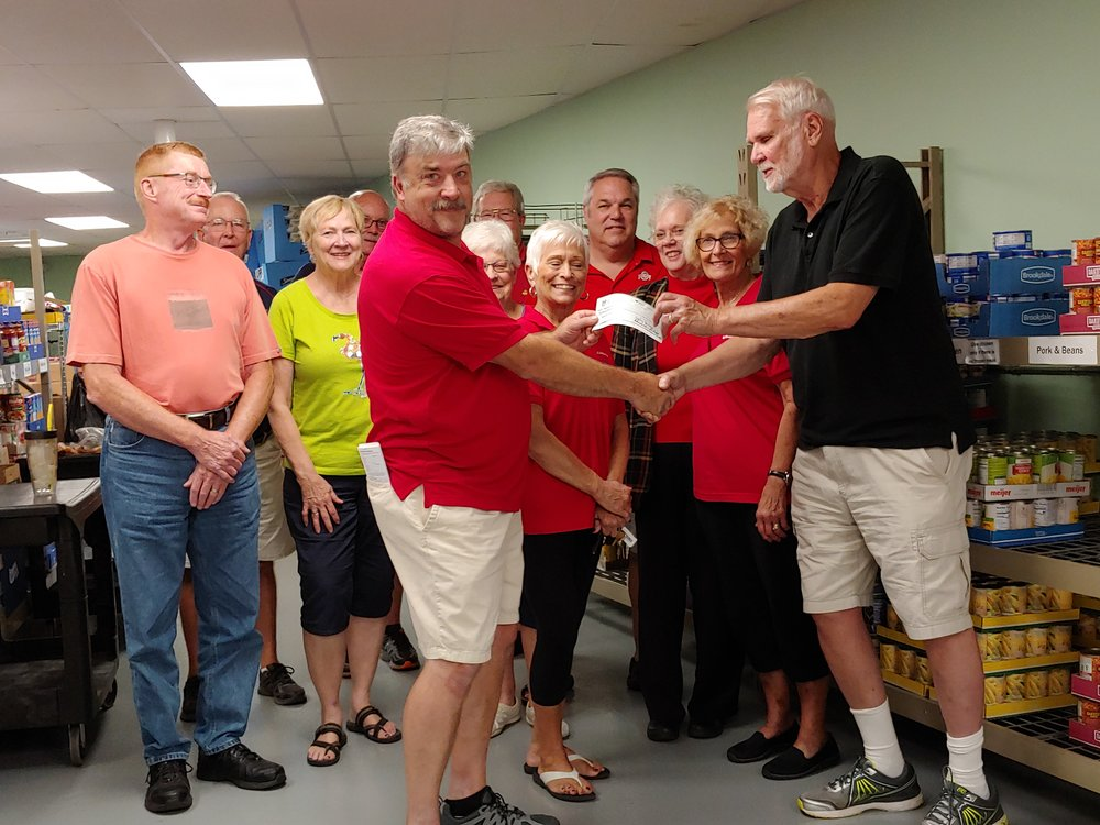 Picture left to right:    Presentation of Check by Exalted Ruler Mike Mowry to Director Roy Wilhelm.    Other left to right:   Jim Faist,  Nancy Francis, Mark Foos, Diann Hamons, Richard & Ann Foos, Rick Franks, Mary Beaston, Jeff & Pastor Jody Rice.