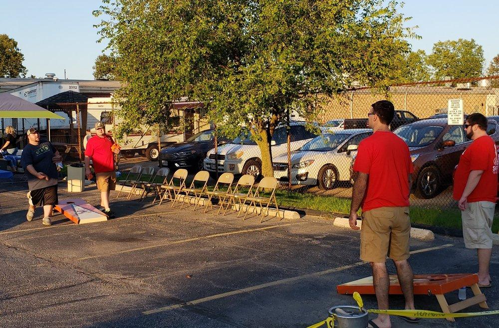 Berea members enjoy a friendly game of cornhole