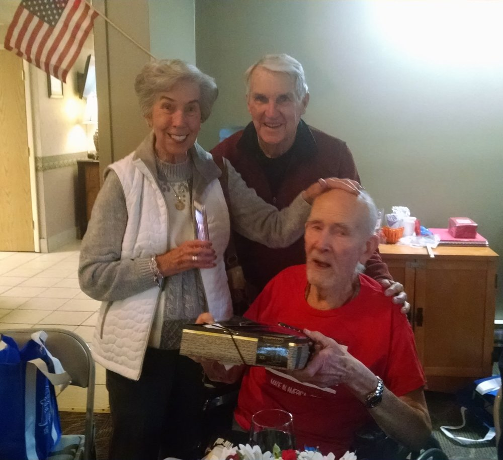 This photo shows a veteran at Country Club Retirement receiving his new pajamas, purchased with a Freedom Grant from the Elks National Foundation. Each veteran at four local nursing homes got a pair of warm pajamas, slippers and a bag of comfort items donated by local school children. These were presented at their Veterans Day Program. Tom and Peggy Cusick are shown in the photo giving a gift to a veteran at the nursing home in Bellaire.