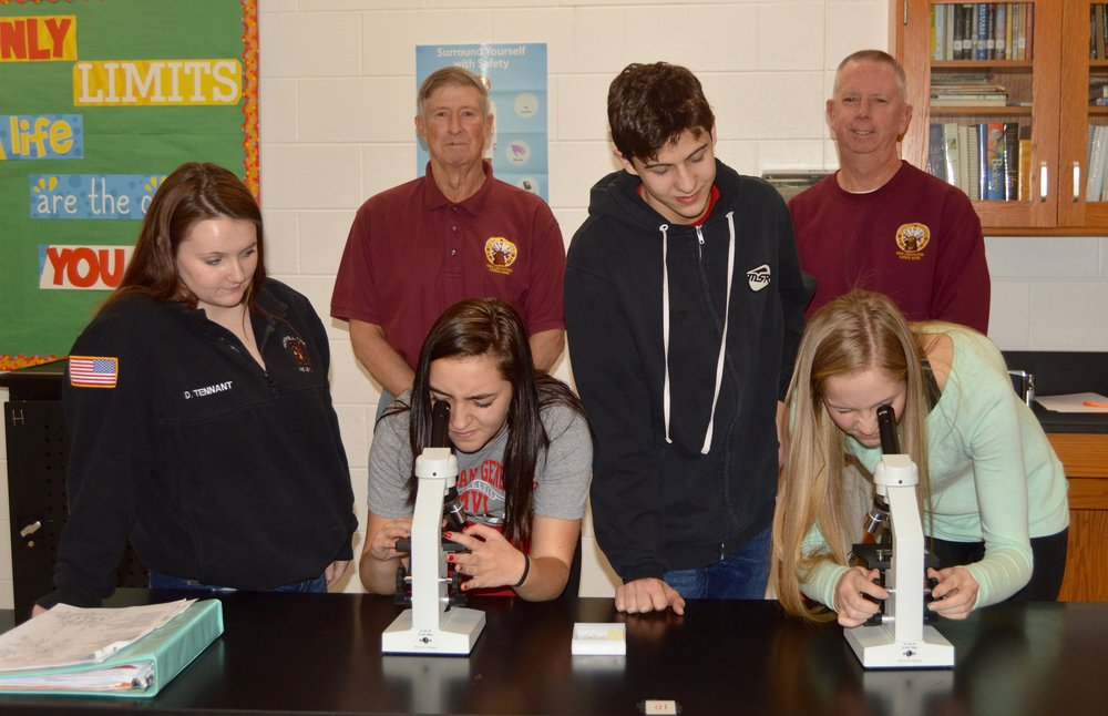 Pictured are students of science teacher Dr. Nancy Rose- Makena Dodson, Brooklyn Frame, Alexandra Fink and Seth Rowley. Representing Lodge #509 are ER Carl Trunko and PER Lodge Treasurer Dan Stanton.