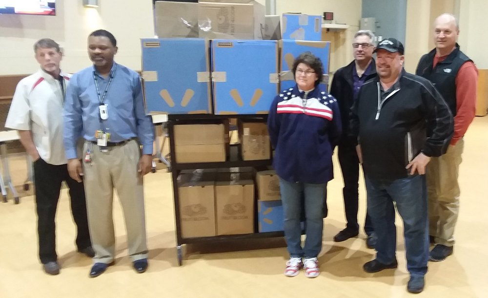 Pictured are Kenneth Carter- Cincinnati VA Activity Supervisor, Debbie Hatcher SW District VAVS Elk Representative, Terry Benson, Hamilton VA Chairman, and Matt Winkler, Michael Smith and Michael Basilone, from the Hamilton Lodge standing in front of the boxes of donations.