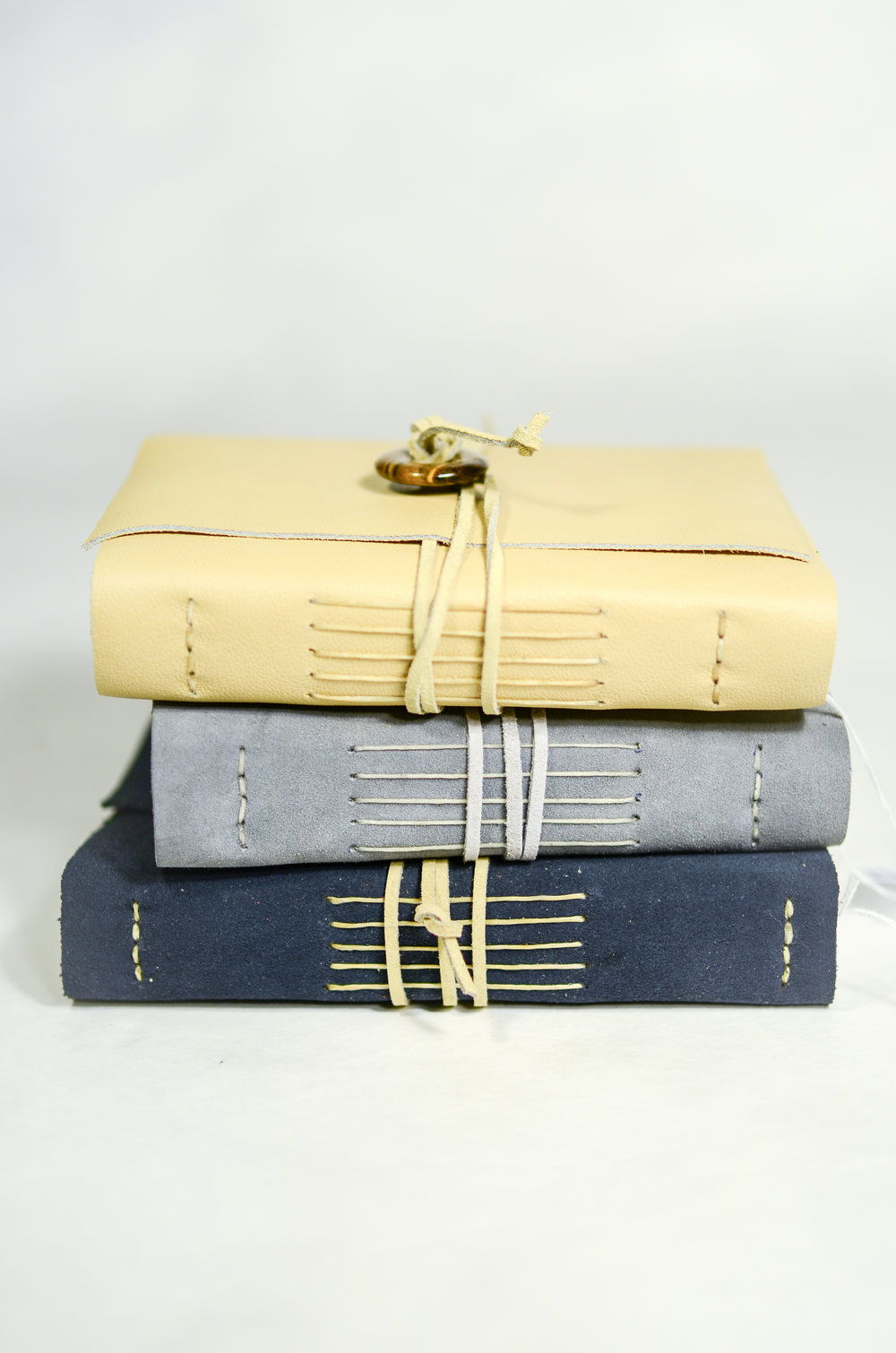9. Michelle Metcalfe Hand-bound Leather Journals, $60.00 each