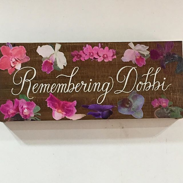 Thank you to @specialscripts one of the many frendors I met at the @gwinnettweddingprofessionals June gathering for transforming this piece of wood with this beautiful calligraphy for my recent event. Also to my godson for using the late Dobbi's photos to show her love for orchids. Great dedication to her life and love for orchids. Team work brings the vision alive. @theflowergirl41  @asilsoccasions