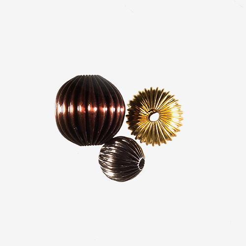 Corrugated   Material: Base & Precious Metals   Corrugated beads have a surface that is molded into alternating groves and ridges.