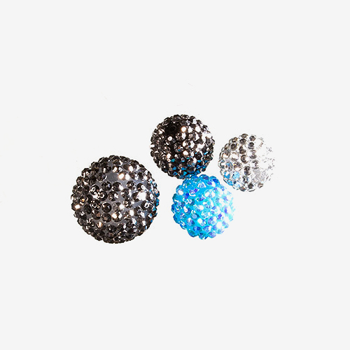 Indonesian Clay & Rhinestone   Material: Clay, Glass & Plastic   Indonesian clay and rhinestone, or sparkle beads, are handmade and covered with rhinestones of faceted plastic, glass or crystal.