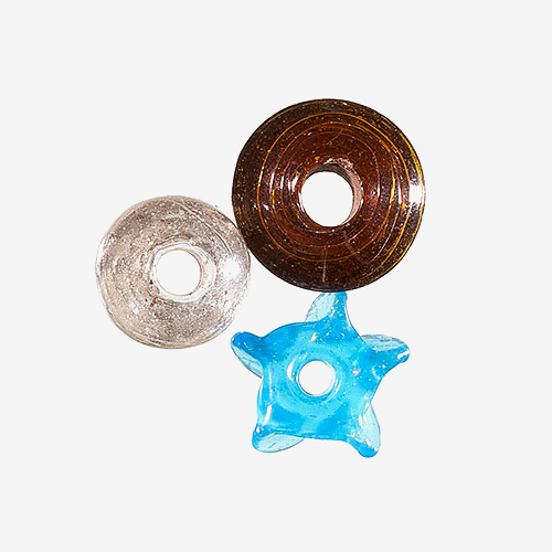 "Planter's Glass   Material: Glass   Planter's beads are glass beads that are baked at low heat in kilns dug into the ground, so they are referred to as ""planter beads"" because they are ""planted"" and come from the ground."
