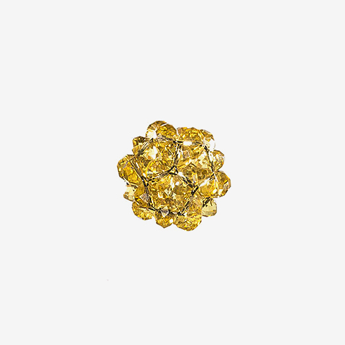 Vintage Pinecone   Material: Lucite & Wire   This vintage bead consists of vintage faceted Lucite beads connected with a wire to form a three dimensional shape that looks like a pinecone.