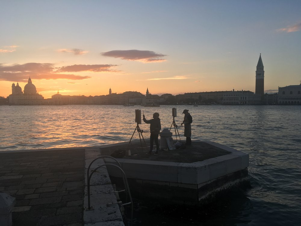 Jennifer Neel (left) with fellow artist Sophie Browning (right) painting the Salute at sunset from San Giorgio Maggiore in Venice, Italy. Photo courtesy of O'Neill Cushman.