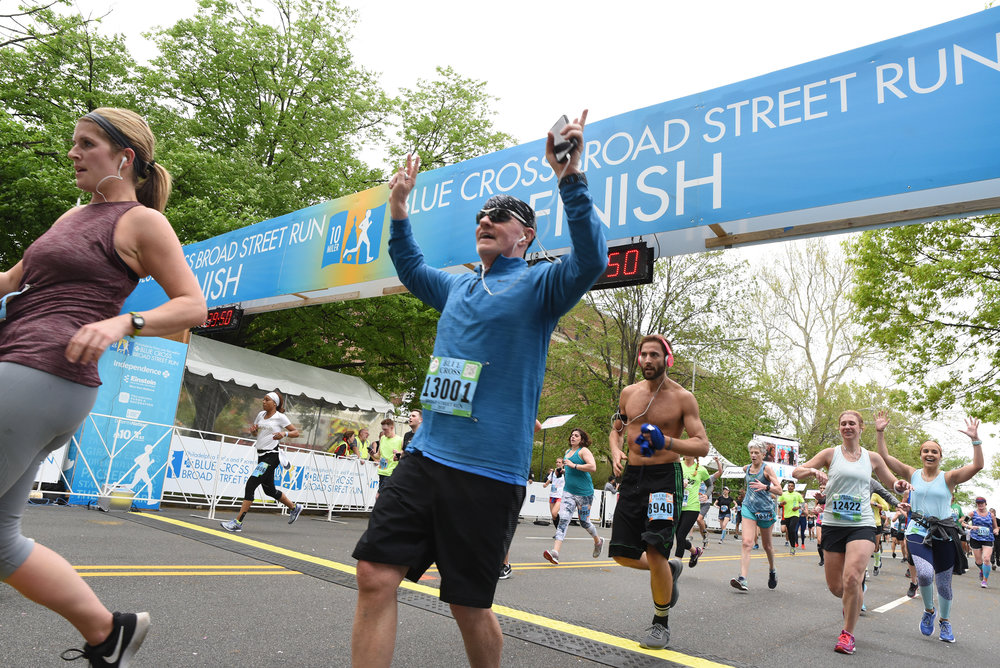 Racers cross the finish line at the Broad Street Run on May 6, 2018. The Broad Street Run is the largest 10-mile race in the country. Brianna Spause / Philadelphia Parks & Recreation