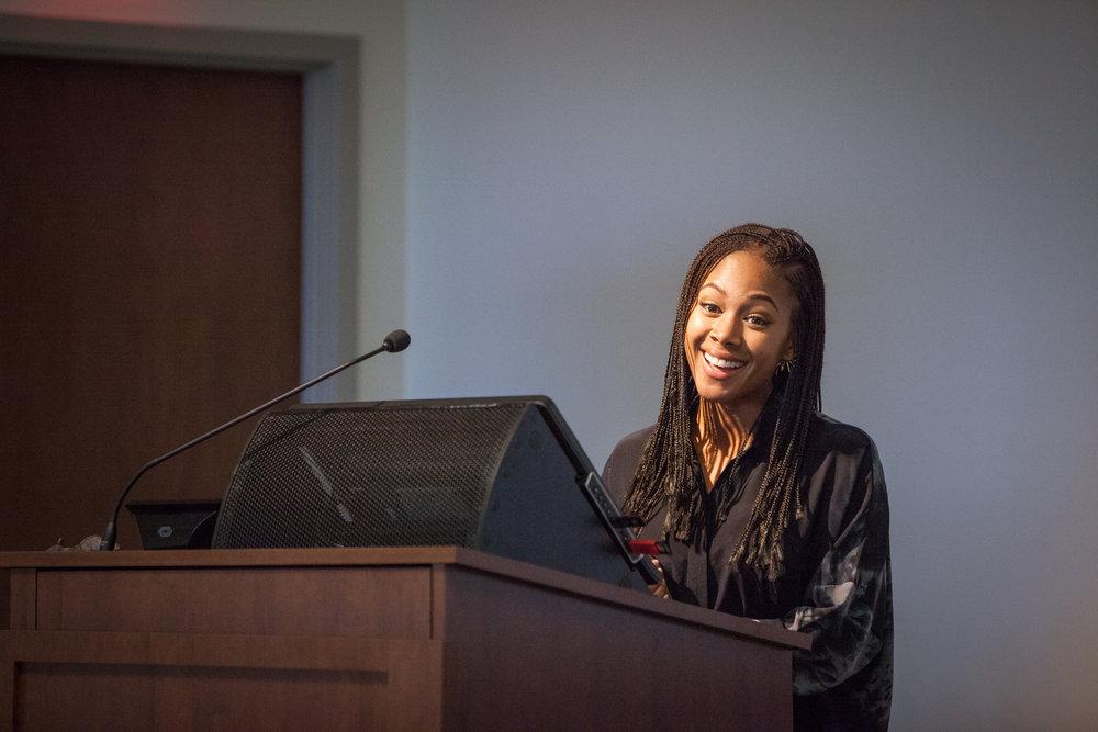 2015 President's Alumni Award Recipient, Nicole Brown, speaking at Artists in Bloom.