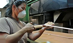 factory_sanding_ukulele_neck.png