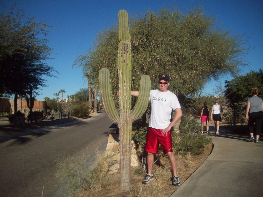 Dr. Steve went to the desert in his B.O. T-Shirt and got a hug from a cactus.