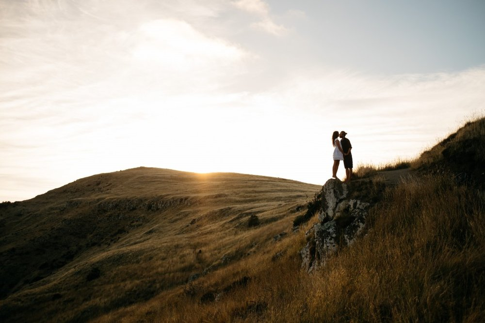 Couple stand on mountain.jpg