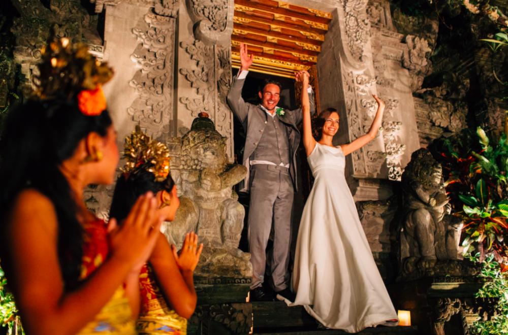 A bride and groom in a Bali temple.png