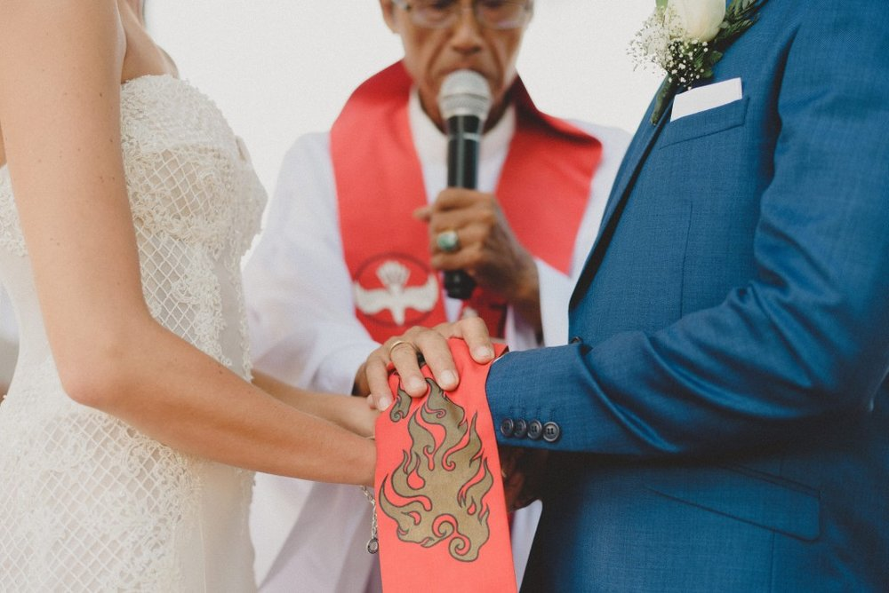 A couple being married by a celebrant at Botanica weddings.jpg