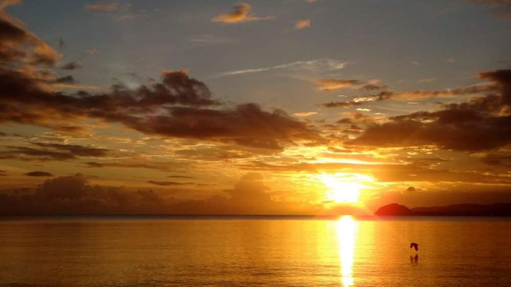 The sun sets over a Fiji Beach wedding.jpg