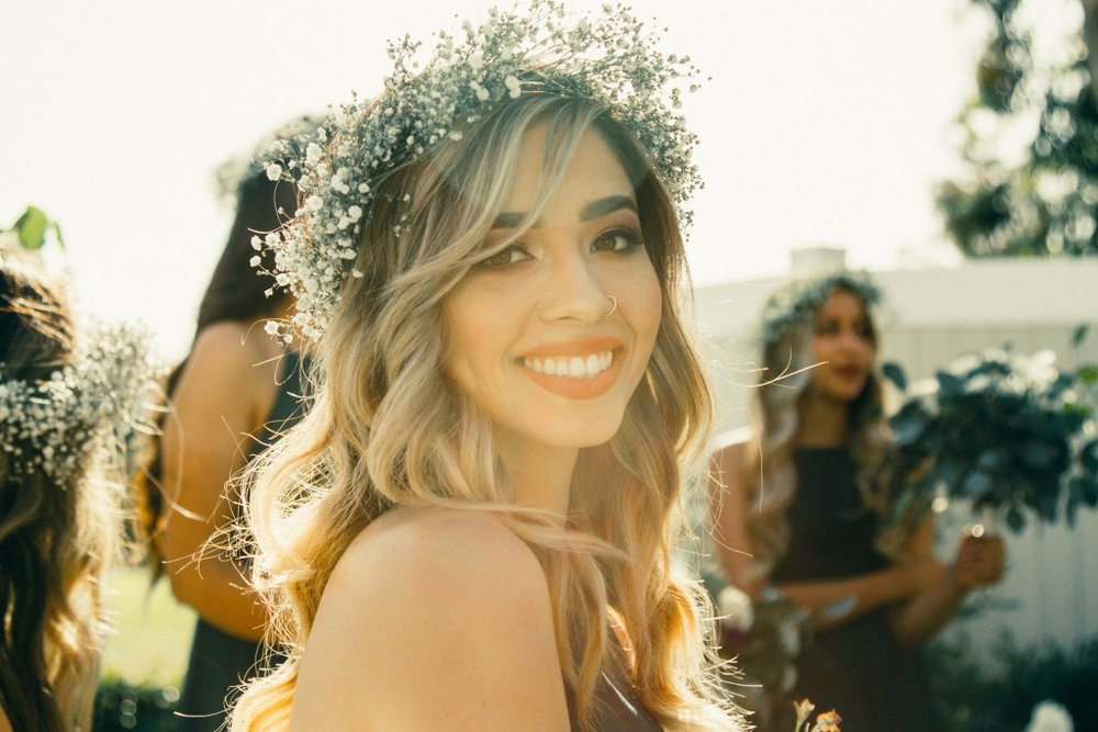 A smiling bride looks directly into the camera.jpg