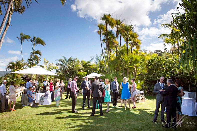 Wedding guests mingle in the garden.jpg