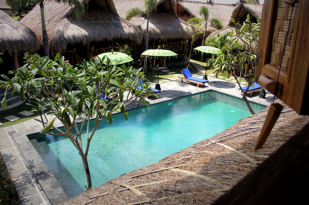 The Calmtree Bungalows - 3 Stars, Canggu - Offering a little bit of quirkiness in the heart of Canggu. Wooden bungalow style accommodation set around a delightful pool area. Walking distance or a short scooter ride to all the attractions. This property also has family bungalows for those travelling with little ones as well.