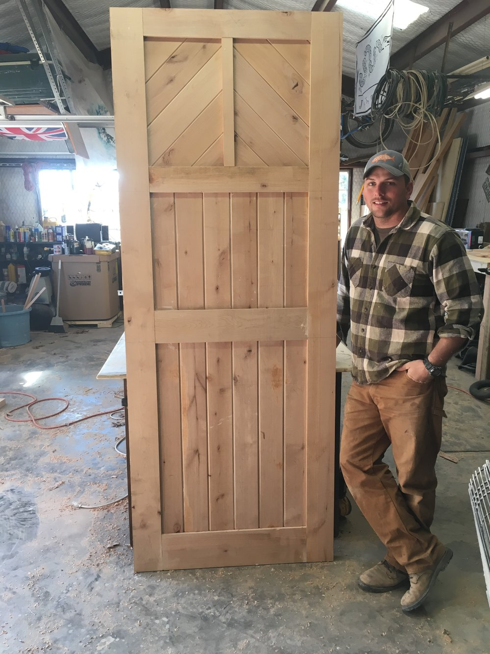 8 ft custom solid wood front door  - We build a custom wood front door for each project.