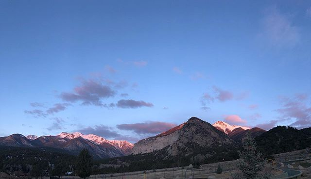 Looking at the mountains for an incredible sunrise. The sun is hitting just the tip of the mountains for a beautiful glow. #justthetip #mountains #colorado #sunrise #travel #pauljoynerphoto