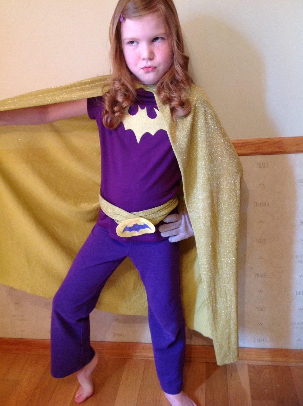 My other fierce daughter showing off her Batgirl skills.