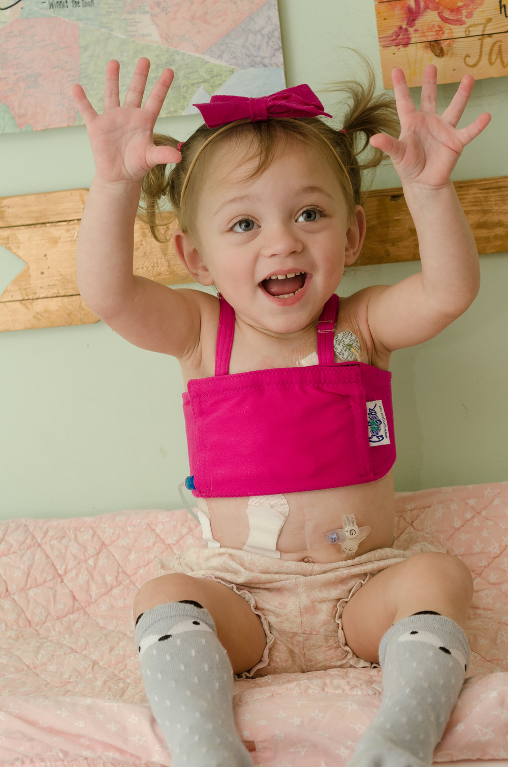 6. Keeps Line Out of Her Hands - Instead of her line hanging directly in front of her, right near her heart, the central line wrap puts it it off to the side. It helps keep it away from those wild yummy hands. The Gus Gear literally covers the line, which keeps it out of sight and out of hands.