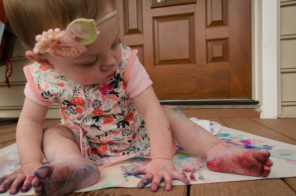 Addie Belle using some edible finger paint