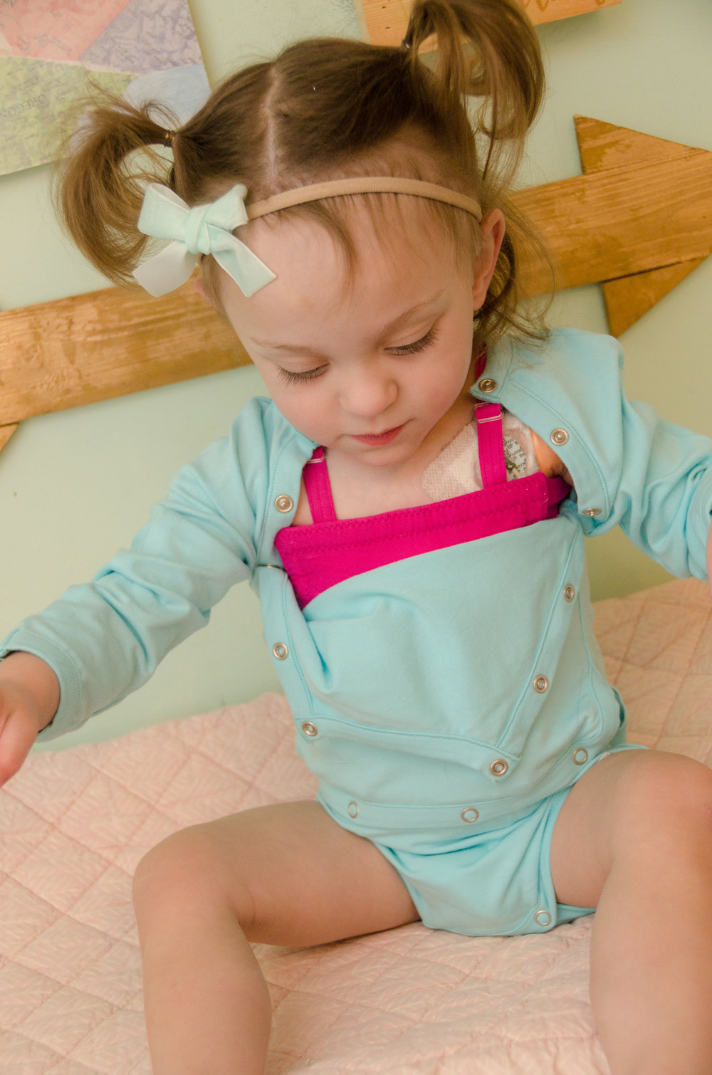 about - Lotsa Brave People© Ports and More™ shirts and bodysuits provide innovative access and tubing management, reducing the risk of infections during treatments while making children more comfortable. Also, we're committed to helping hospitals enhance their standard of care and offering improved clothing options for caregivers and patients.