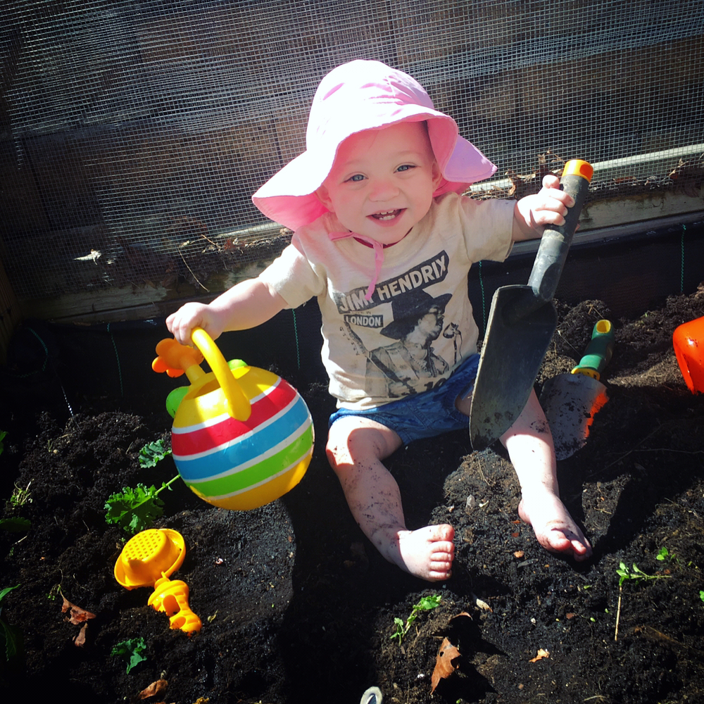 Addie Belle helping Mama with our very first garden together.