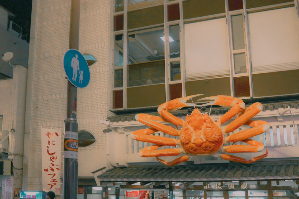 The iconic Kani Douraku Dotonbori Honten. Known for its iconic crab. Also known for its 1 hour waiting time.