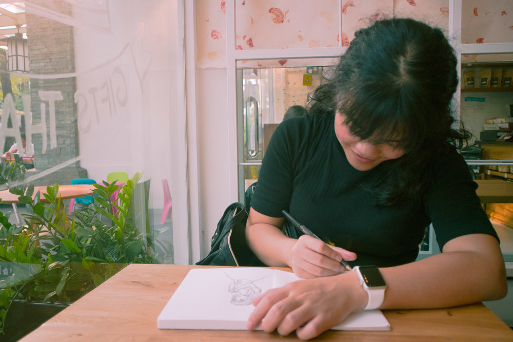 As a freelance creative, I get to express my creativity clearer in my work and I get the time I need to work on some things for myself: like this passion project! Here I am sketching at a cafe wondering what my passion project would look like.