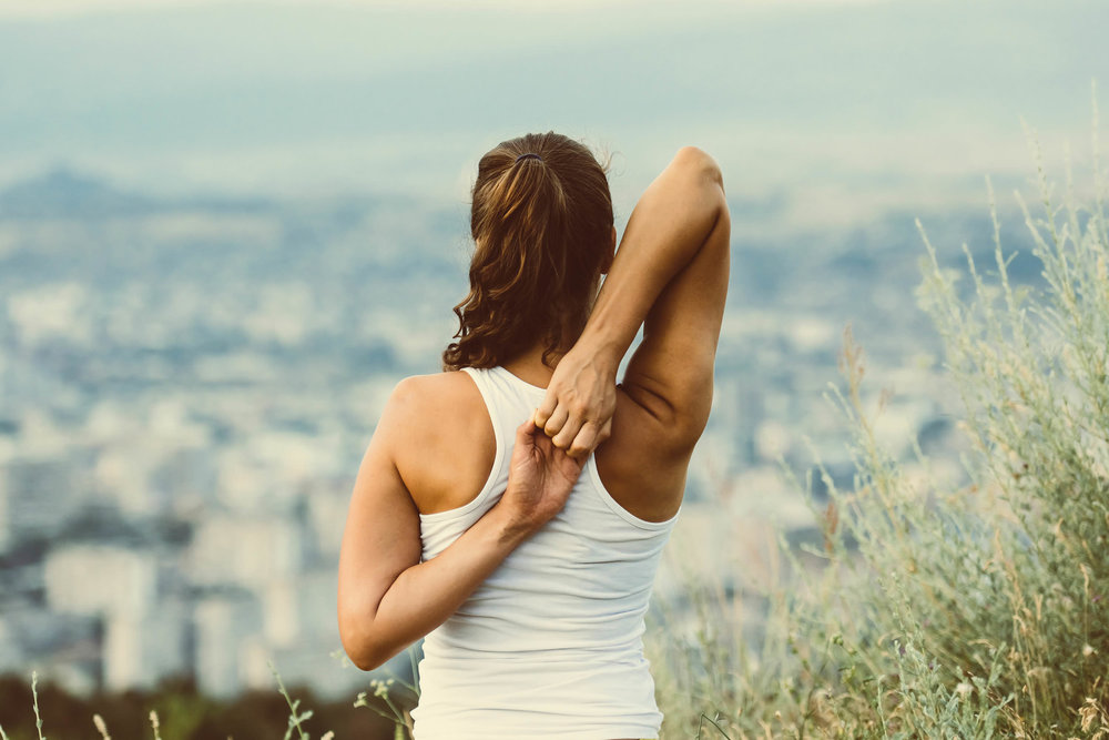 woman stretching  with a view.jpg