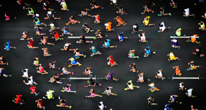 Dublin marathon runners on road in high vis clothing.jpg