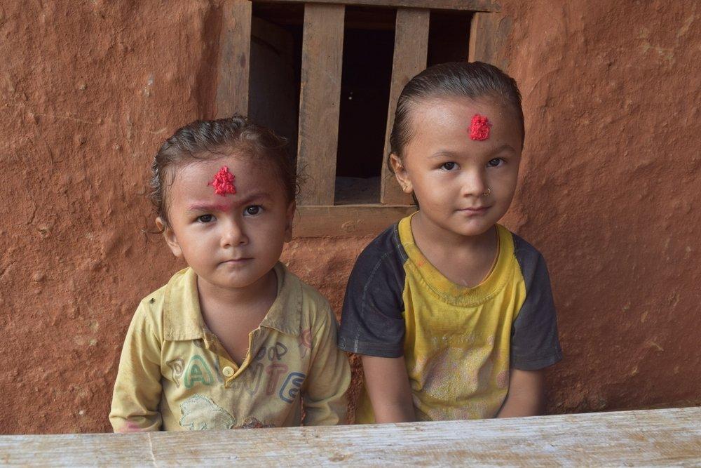 Grandchildren of my host family in Ramechhap after receiving a Tikka blessing.