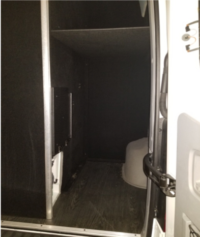 Carpeted Trunk storage area with fold down shelf, lighting