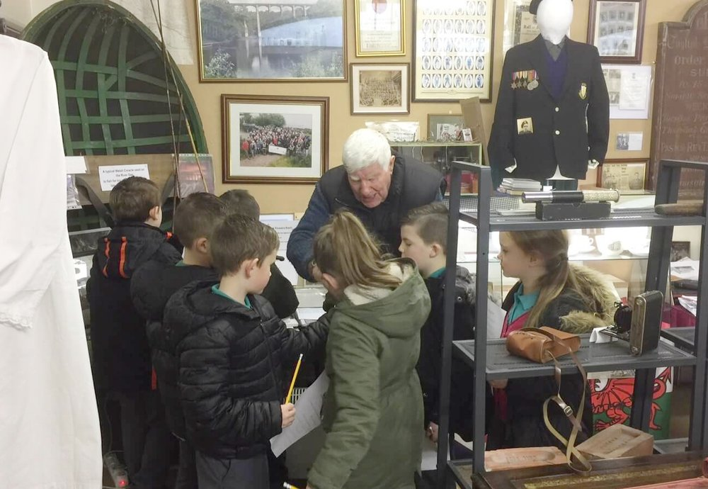 Committee member talking with local children in the museum