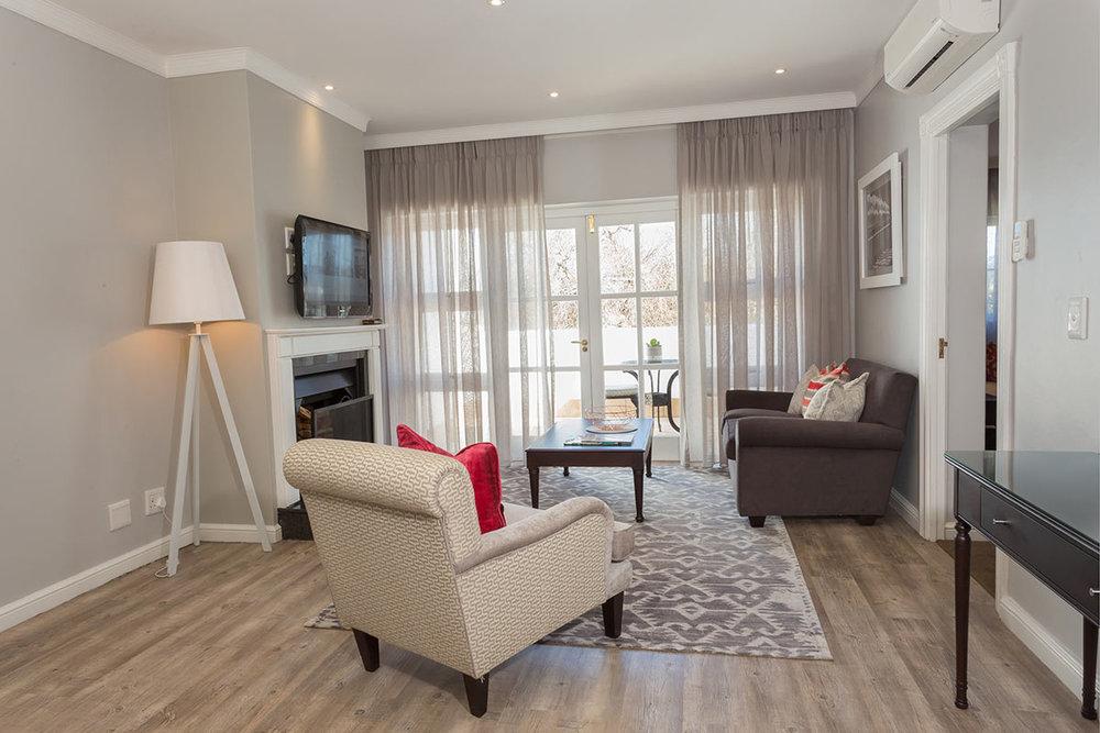 Fancourt-Hotel_One_Bedroom-Suite-Lounge-Area.jpg