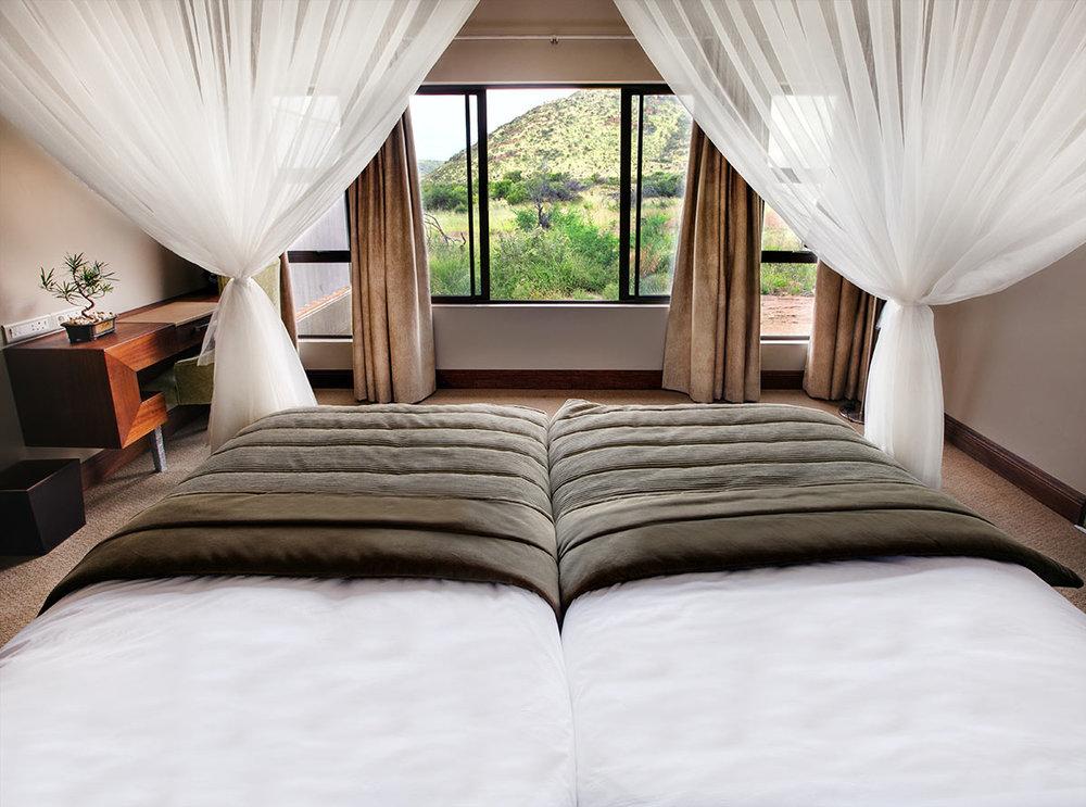 Shepherds-Tree-Game-Lodge_Luxury-Suite_Bedroom.jpg