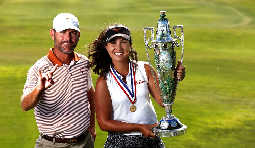 Sophia Schubert holds the Robert Cox trophy after winning the U.S. Women's Amateur with help from her college coach and caddie, Ryan Murphy. USGA/Steven Gibbons