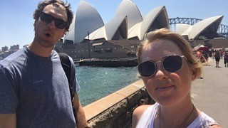 Casey and her caddie, Austin, at the Sydney Opera House.