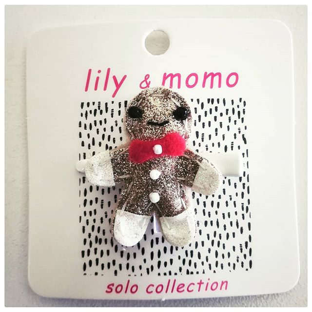 Adorable little gingerbread man barrette by @lilyandmomo available at both locations. We love small things!