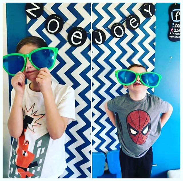 These young dudes had fun with props at our East location photo booth. Photo courtesy of Jenn McCarty.