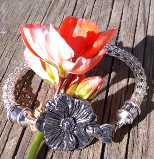 flower bee viking bracelet.jpg