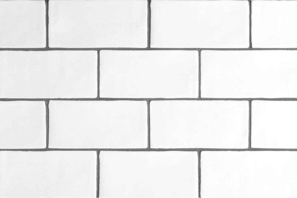 backsplash  This rectangular-shaped tile decorative creates an artful break in patterns. The right kind of tile decorative can add a colorful and artistic boost to the rooms in your home. Tiles are an easy way to make an instant impact in kitchens, bathrooms, and more.
