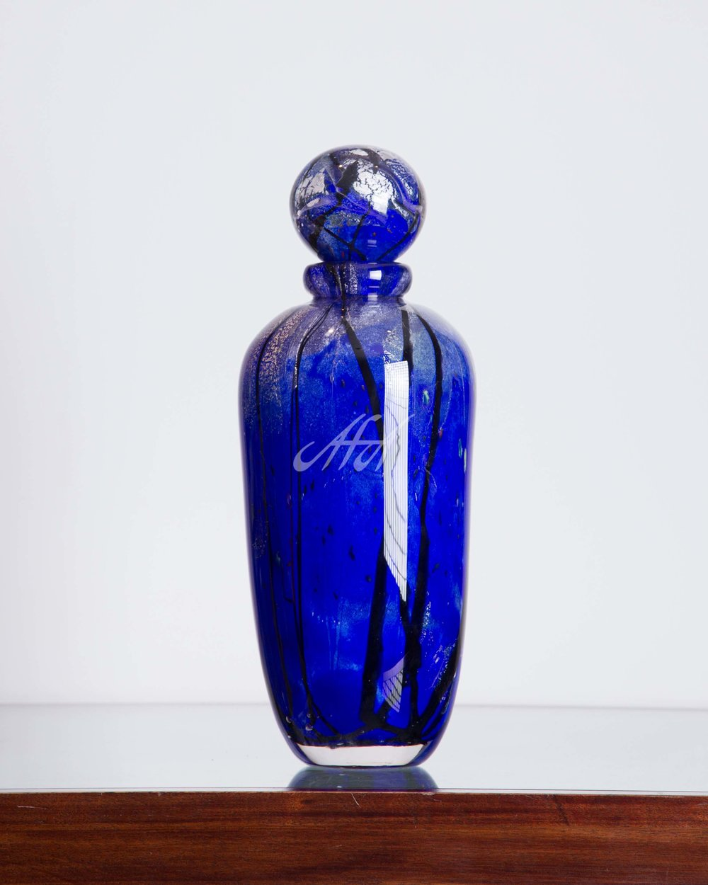 AFA_LL_RoyalBlue_Bottle watermark lores.jpg