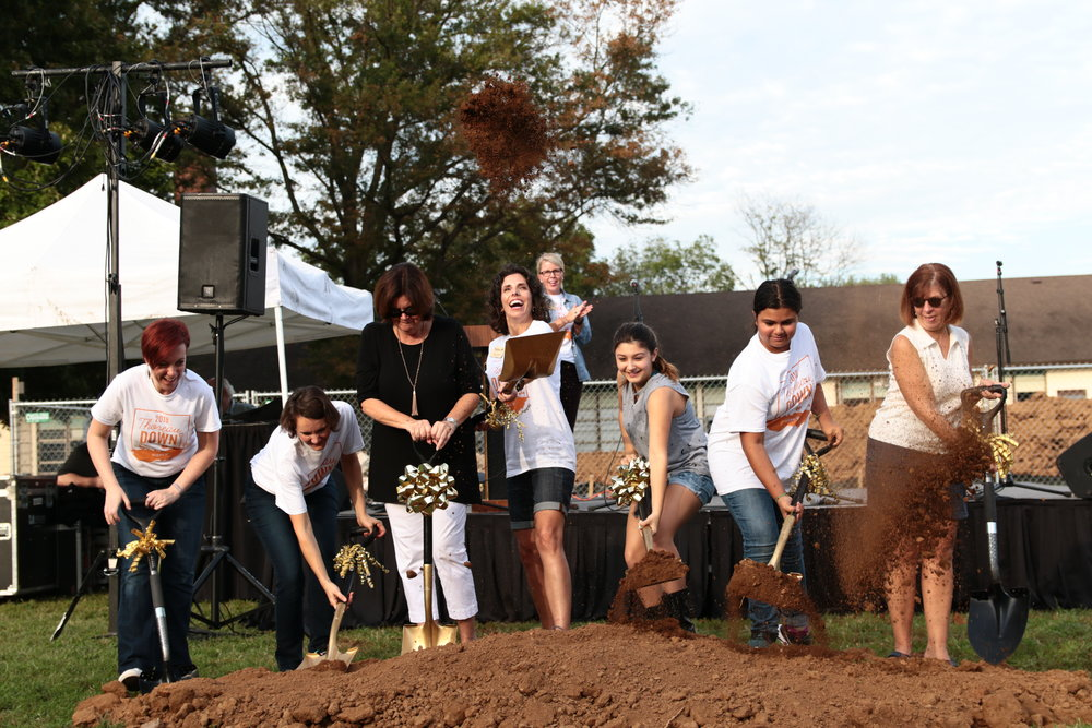 Thoreau Down Groundbreaking Ceremony - September 14, 2018 - Mind the construction! Amidst the backdrop of the annual, festive Thoreau Down event (featuring a chili cook-off and the Alumni Association Drum Award presentation) a public groundbreaking was held for the Walden community. The churned earth for the ceremony seemed small compared to the massive mounds of tilled ground in the actual construction zone. The building progress over the summer was transformative!