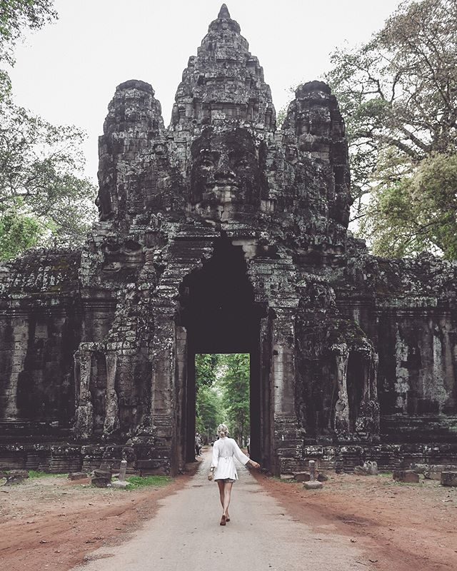 """the gate to enter the cambodian history.🍂 SWIPE for the AFTER & BEFORE. -edited with the """"T_MYSTICAL"""" PRESET from my Lightroom preset """"TRAVEL COLLECTION.  get it now for 24% off- link in bio.🐒"""